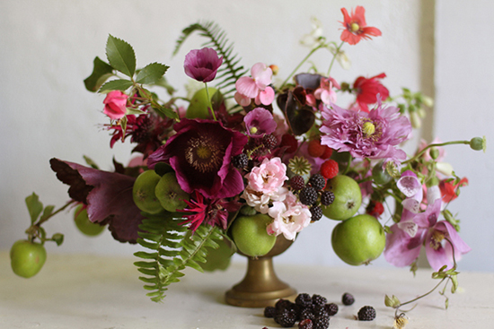 Amy Merrick's floral design fruit and flowers.