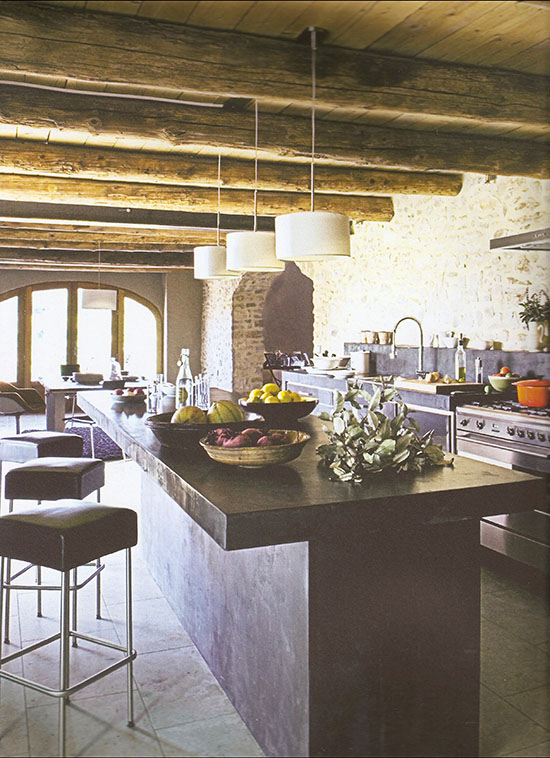 A modern rustic kitchen in a renovated barn in France.