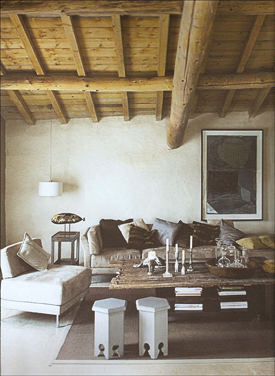 A modern rustic living room in a renovated barn in France.