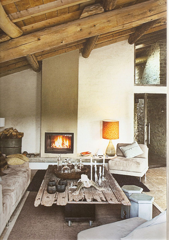 A modern earthy living room in a renovated barn in France.